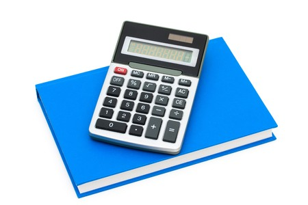 A calculator on a book isolated on white, Cost of education  Stock Photo - 7356279