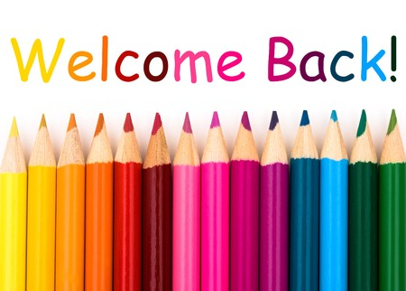 Colorful pencil crayons on a white background, Welcome Back Stock Photo