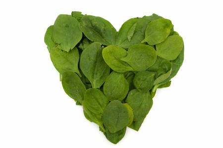 Een stapel van spinazie geïsoleerd op wit, Heart Friendly Super Food Spinazie Stockfoto