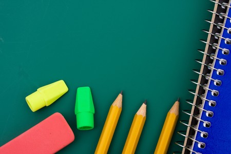 Some pencils and scribbler on a chalkboard, back to school Stock Photo