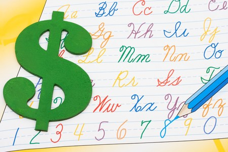 workbook: A grade school workbook for writing, Cost of education  Stock Photo