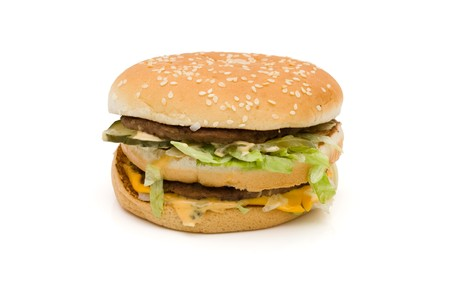 A cheeseburger isolated on a white background, fast food