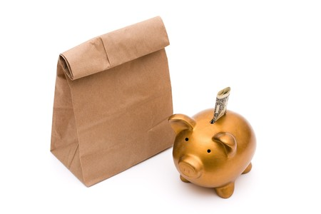 money packs: A gold piggy bank with a brown paper bag isolated on a white background, saving your lunch money