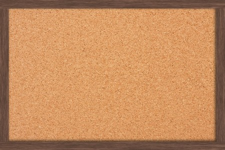 A cork bulletin board with a wooden frame, bulletin board