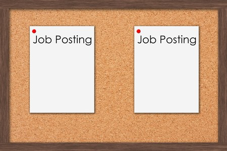A cork bulletin board with job postings and a wooden frame, Job Postings photo