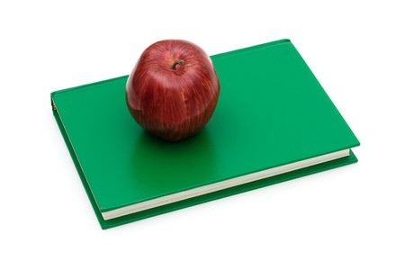 An apple on a stack of books isolated on a white background, school work photo