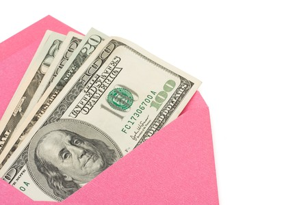 envelope: A pink envelope with cash in it isolated on a white background, gift of cash