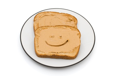 breakfast smiley face: Two pieces of whole wheat toast isolated on a white background, Peanut Butter and Whole Wheat Toast