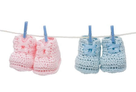 Retro hand made baby booties isolated on a white background Stock Photo