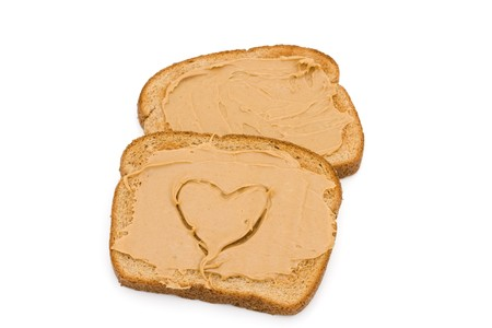 peanut butter: Two pieces of whole wheat toast isolated on a white background, Liking peanut butter toast