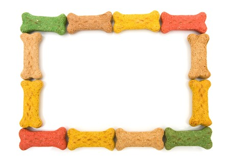 Dog treats making a border isolated on a white background, dog border photo