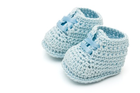Handmade blue baby booties isolated on a white background Stok Fotoğraf