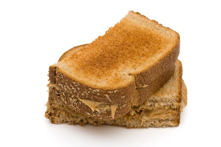 Two pieces of whole wheat toast isolated on a white background, Peanut butter sandwich Stock Photo - 7593086