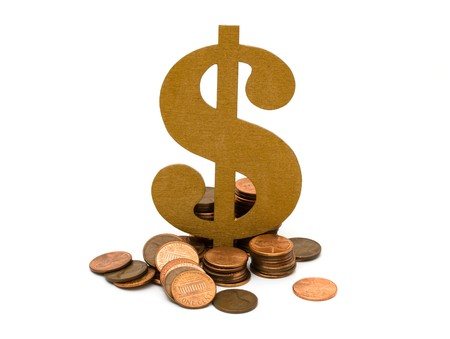 A golden dollar sign with a lot of pennies isolated on a white background, Money Matters Stock Photo