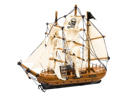 A pirate ship with a flag isolated on white Stock Photo