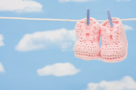 Retro hand made baby booties hanging on a clothesline photo