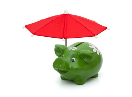 A red umbrella covering a piggy bank isolated on a white background, Protecting your money
