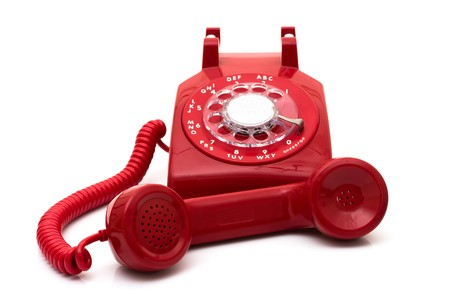 rotary dial telephone: A red retro telephone isolated on white, Call for help Stock Photo