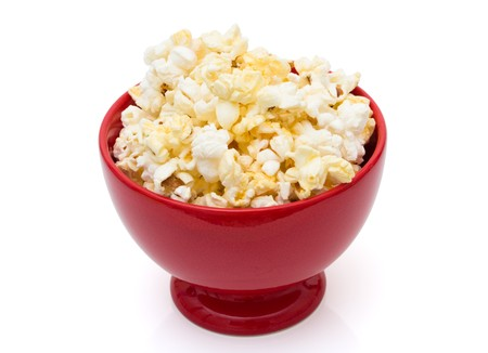 buttery: Buttered popcorn snack in a bright red bowl isolated over white,  Tasty Butter Popcorn Stock Photo