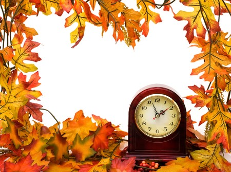 Fall leaves with clock isolated on white, Fall time change photo