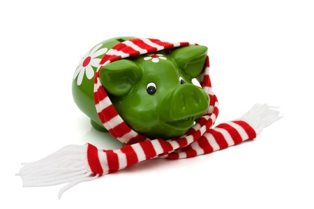 christmas savings: Cute piggy bank with a winter Christmas scarf isolated on white, Christmas Savings Stock Photo