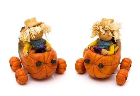 Two cute scarecrows isolated on white, autumn fun photo