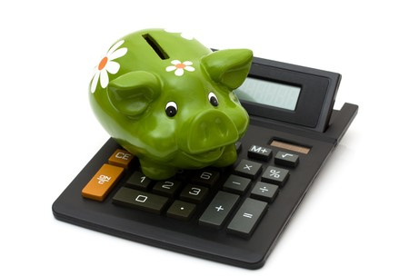 A black calculator with a piggy bank isolated on a white background, Calculating your savings Stock Photo - 8053356