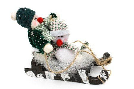 Two snowmen on a sled isolated on white background, Snowman having fun photo