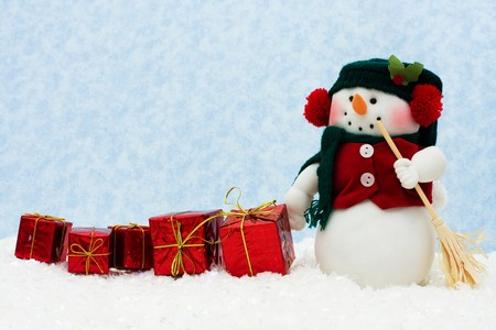 Snowman with a line of presents on snow, Winter Scene  photo