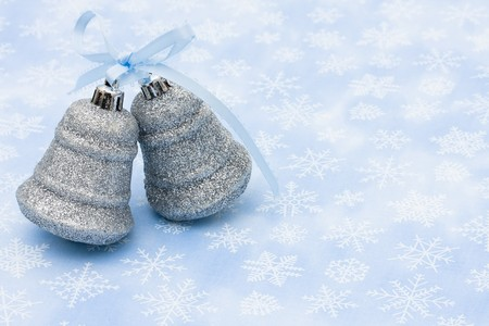 silver bells: Two silver bells on a blue snowflake background, Christmas Time