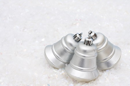 silver bells: Three silver bells on a white textured background, Christmas Time