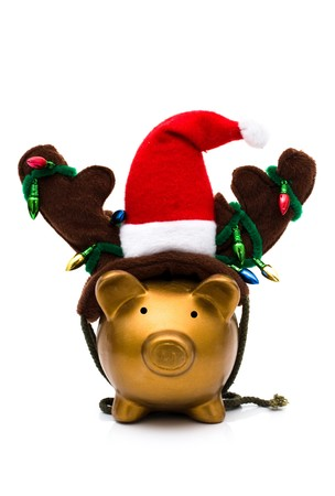 christmas savings: A piggy bank with a santa hat, reindeer antlers and christmas lights isolated on a white background, christmas savings Stock Photo