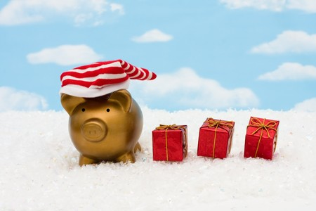 christmas savings: A piggy bank with a striped hat on a sky background, christmas savings