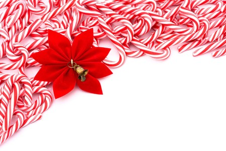 Mini candy canes making a border on a white background, Christmas Time