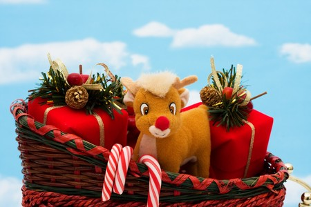 A wicker sleigh with presents in it with a sky background, Santa sleigh Stock Photo - 8215626