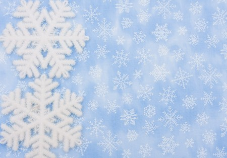 Two snowflakes on a blue snowflake background, Winter Time photo