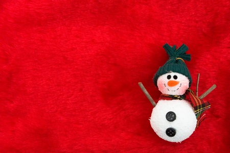 A snowman on a red background, Christmas Time photo