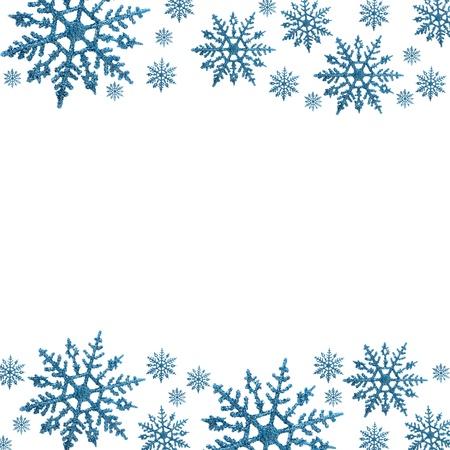 holidays: Snowflake border with white background, winter time Stock Photo