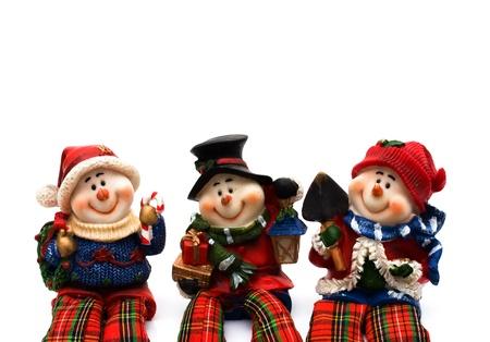 Three snowmen isolated on a white background, Christmas Time Stock Photo - 8228292