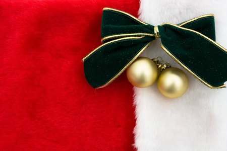 christmas sock: A green velvet bow with glass balls on a red christmas stocking background, Christmas Time