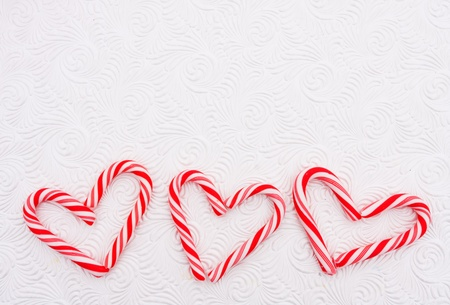 Two candy canes making a heart on a white background, Candy cane heart photo