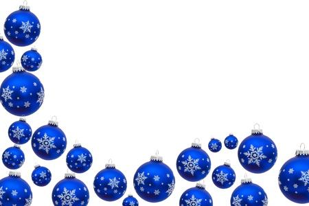Blue christmas balls making a border with white background, christmas border Foto de archivo