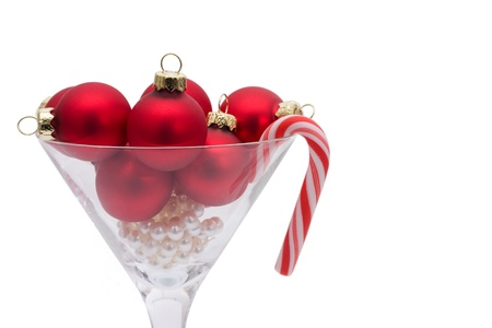 Red christmas balls in a martini glass isolated on a  white background, Christmas time photo