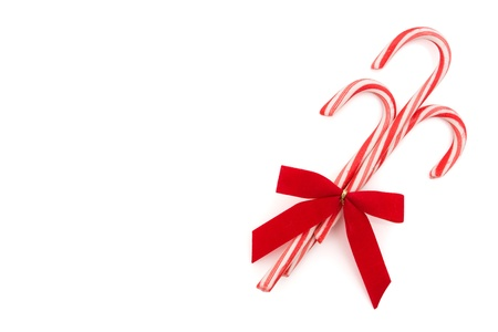 Three candy canes on a white background, candy cane background photo