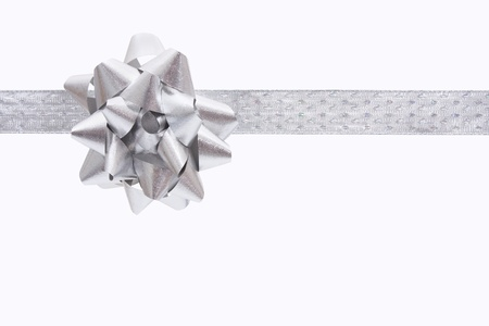 A ribbon and bow on a white background, christmas present Stock Photo - 8279467