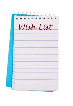 Un bloc de notas con la lista de deseos, escrita en ella aislado en un fondo blanco, lista de deseos de Navidad Foto de archivo