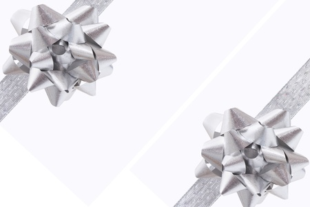 silver ribbon: A ribbon and bow on a white background, christmas present
