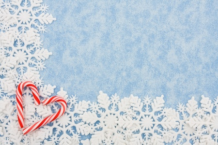 Snowflake border on a blue background, winter time photo