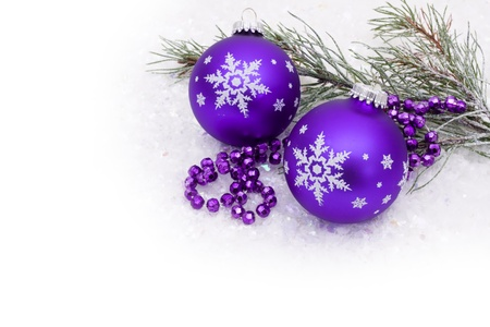 Purple christmas ball on snow with a snow background, christmas time Stock Photo