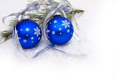 Blue christmas balls on a snow background, christmas time photo